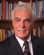 Dr Gerry George